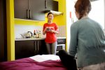 INTO-students-in-bedroom-with-kitchen-PR